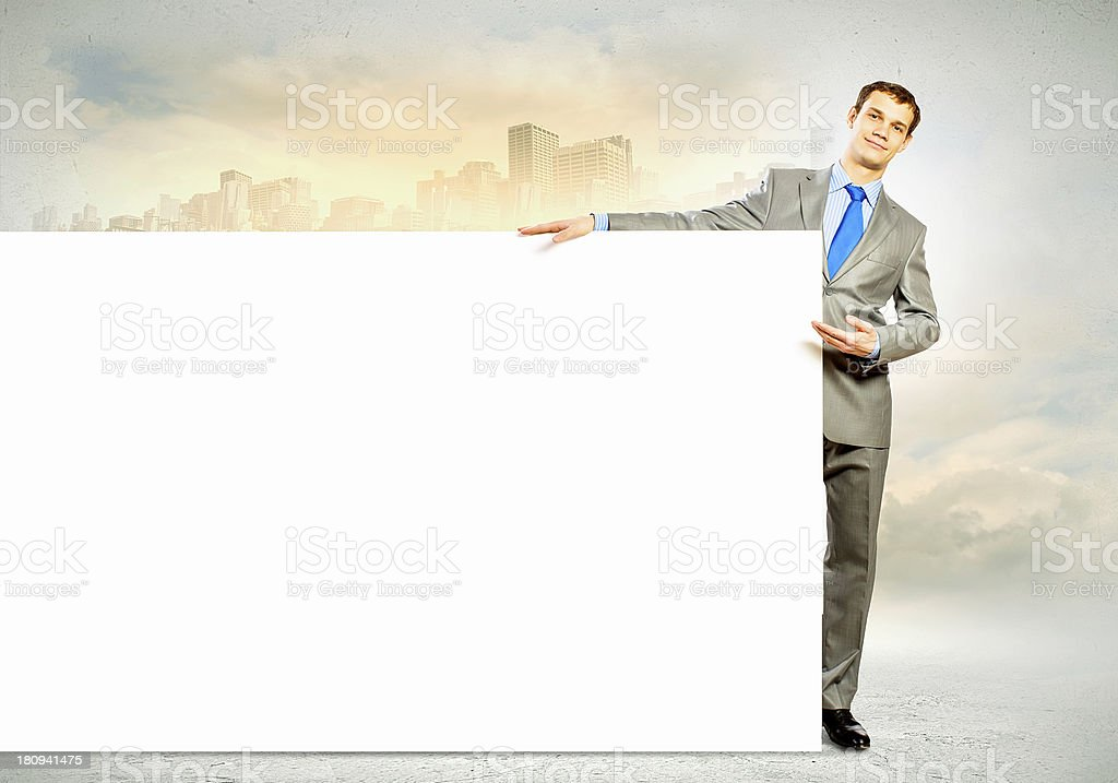 Businessman with blank banner royalty-free stock photo