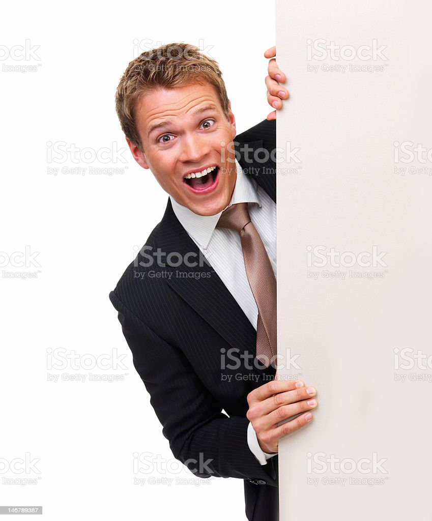 Businessman with blank signboard against white background royalty-free stock photo