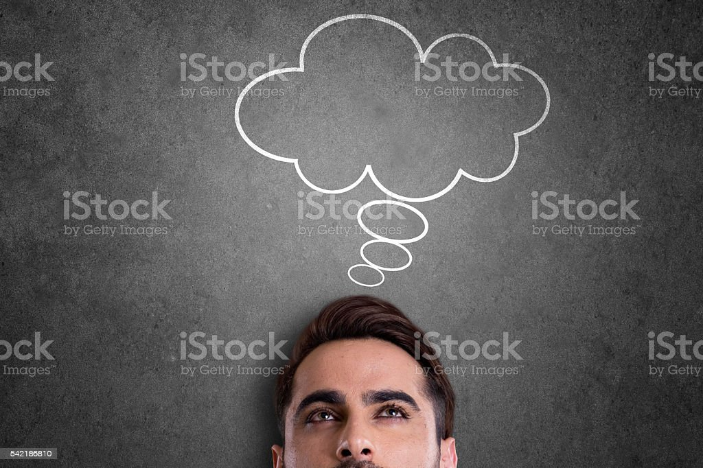 Businessman with blank thought bubble stock photo