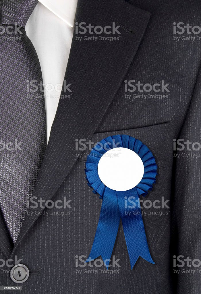 Businessman with blue ribbon attached to his jacket royalty-free stock photo