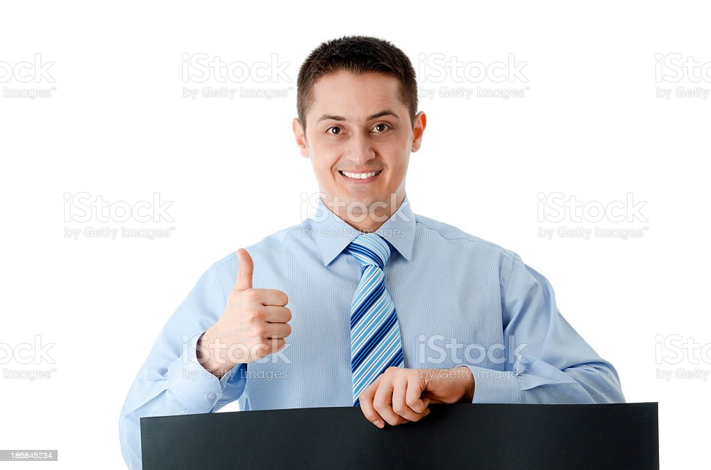 Businessman with board and thumb up, isolated on white royalty-free stock photo