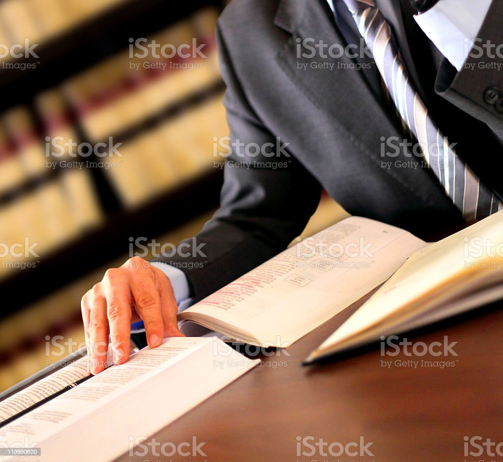 Businessman with books and notes stock photo