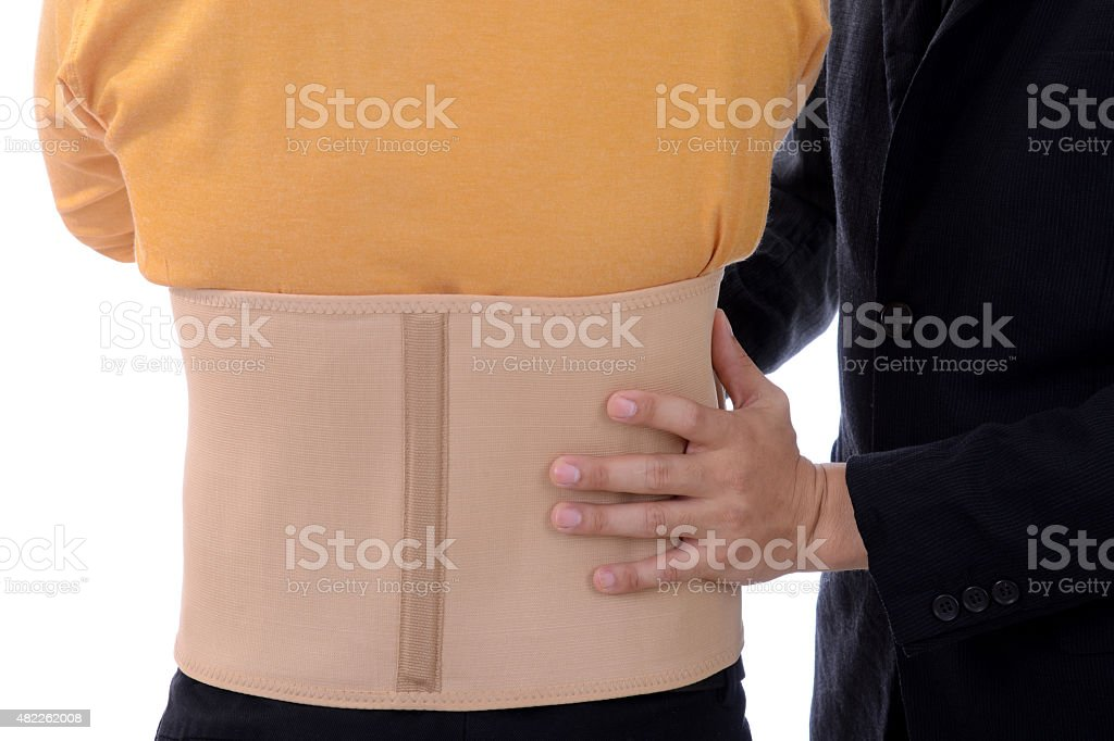 Businessman with brace back support protection pain problem stock photo