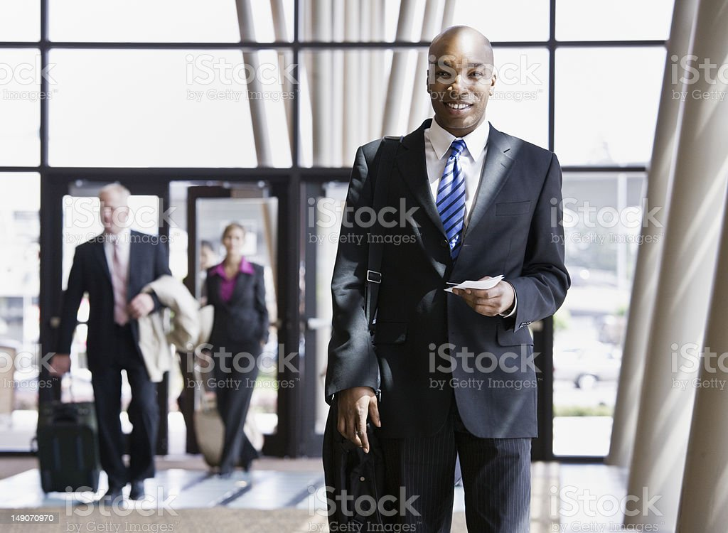 Businessman With Briefcase And Passport royalty-free stock photo