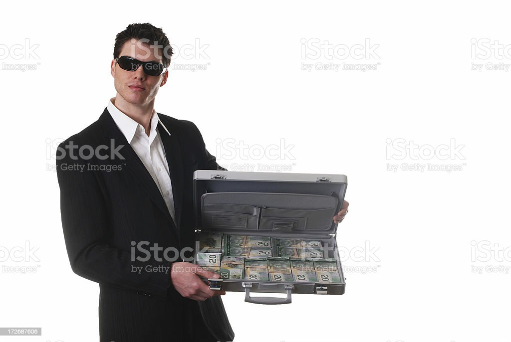 Businessman with  briefcase full of Money stock photo