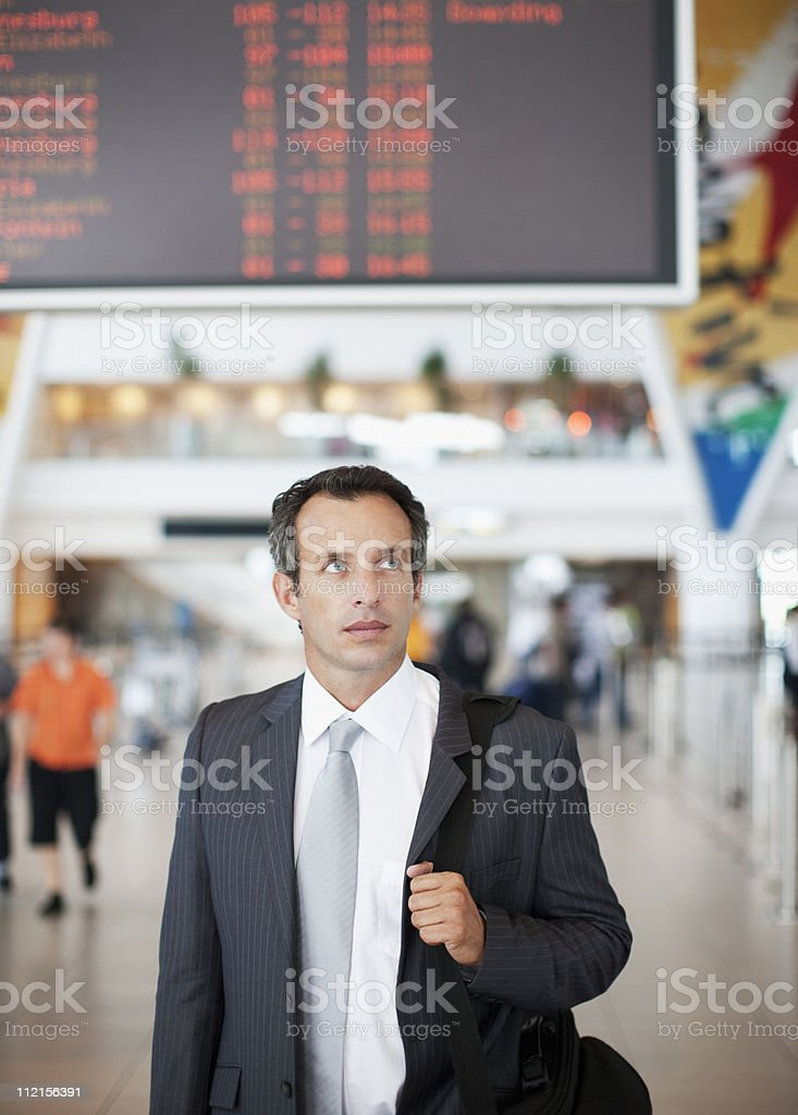 Businessman with briefcase in airport royalty-free stock photo