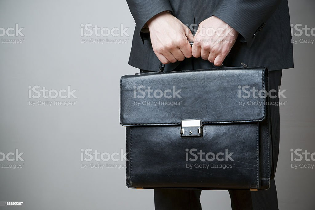 Businessman with briefcase in hand stock photo