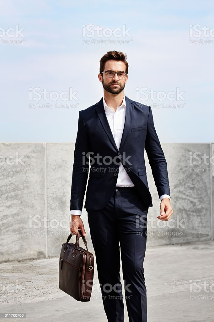 Businessman with briefcase stock photo