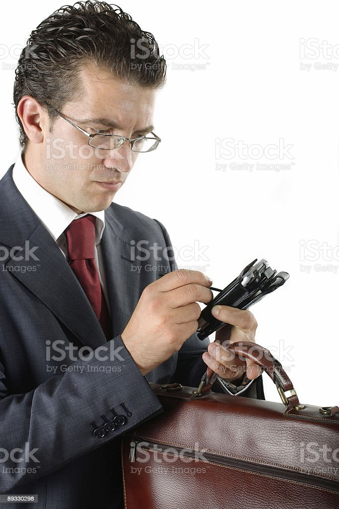 businessman with briefcase using pda royalty-free stock photo