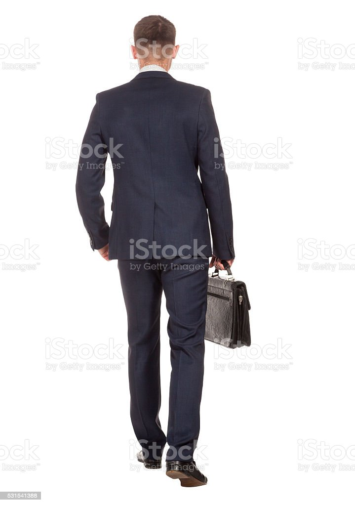 Businessman with briefcase walking away on white stock photo