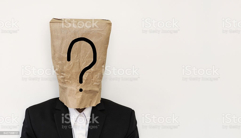 Businessman with brown paper bag on head, with question mark stock photo