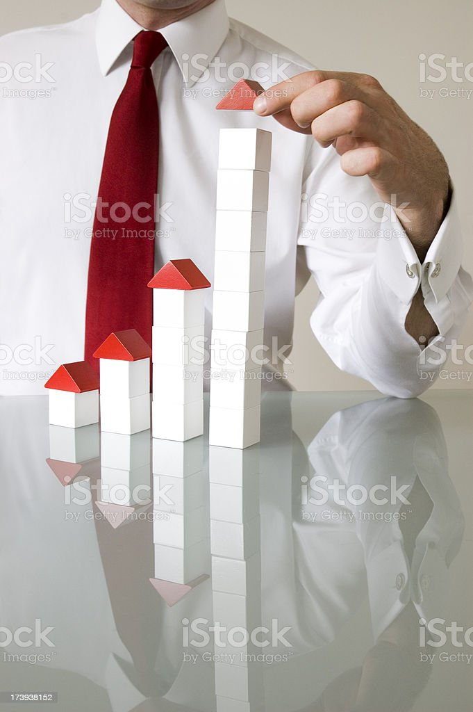 Businessman with building blocks to denote growth royalty-free stock photo
