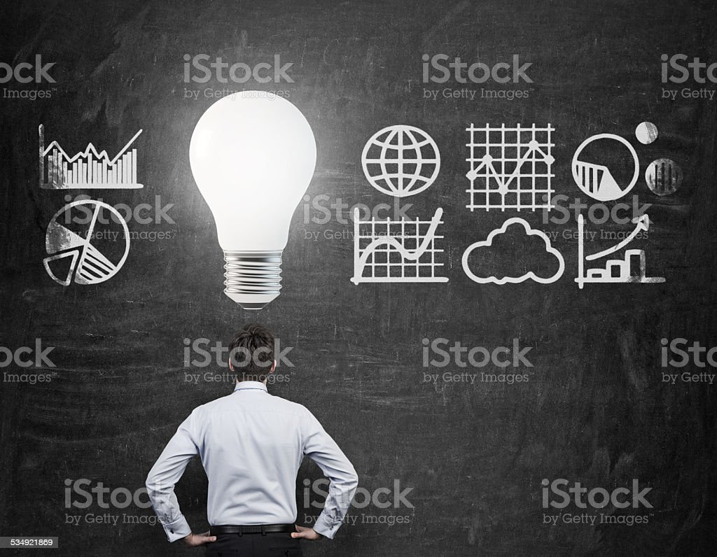 businessman with bulb over head stock photo