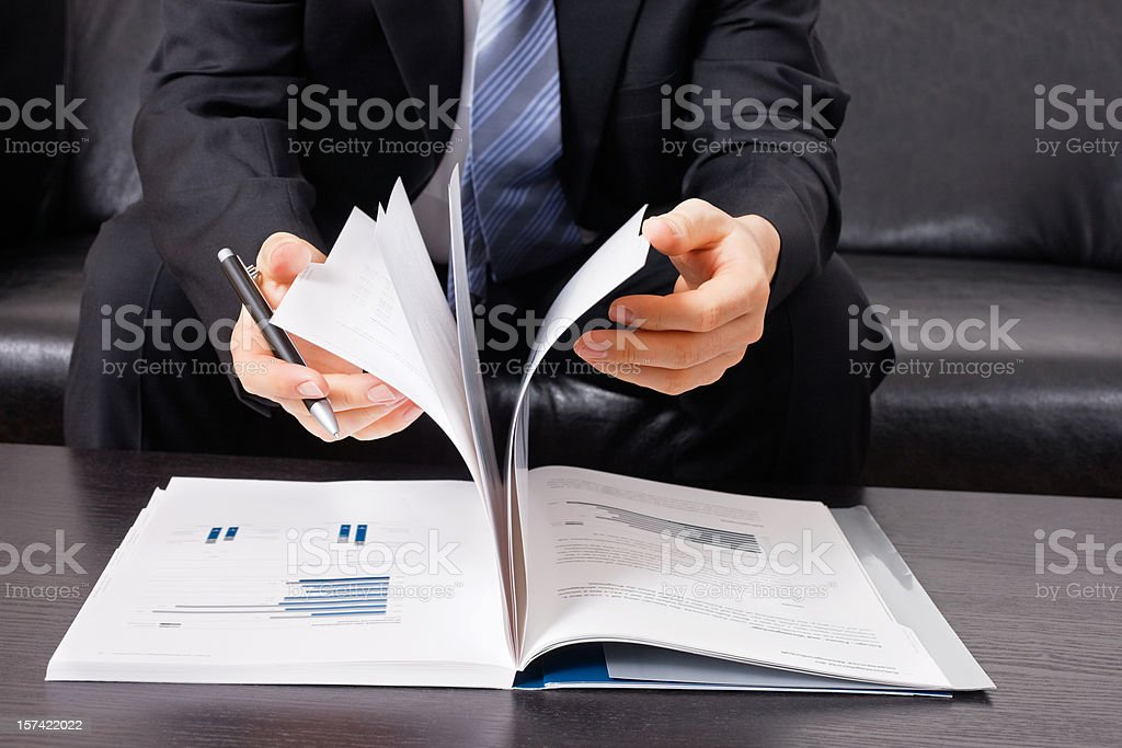 Businessman with business report and pen royalty-free stock photo