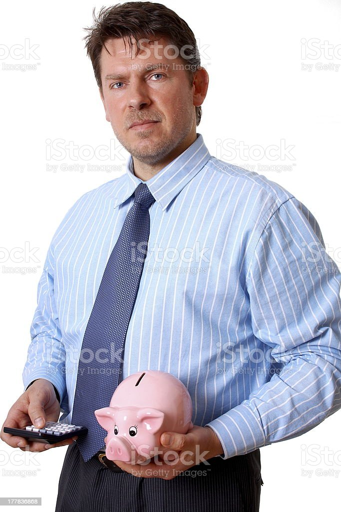 Businessman with calculator and pink piggy bank royalty-free stock photo