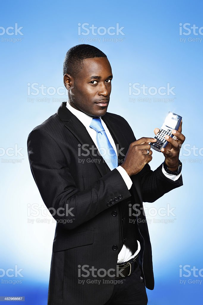 Businessman with calculator warns: the numbers look bad! royalty-free stock photo