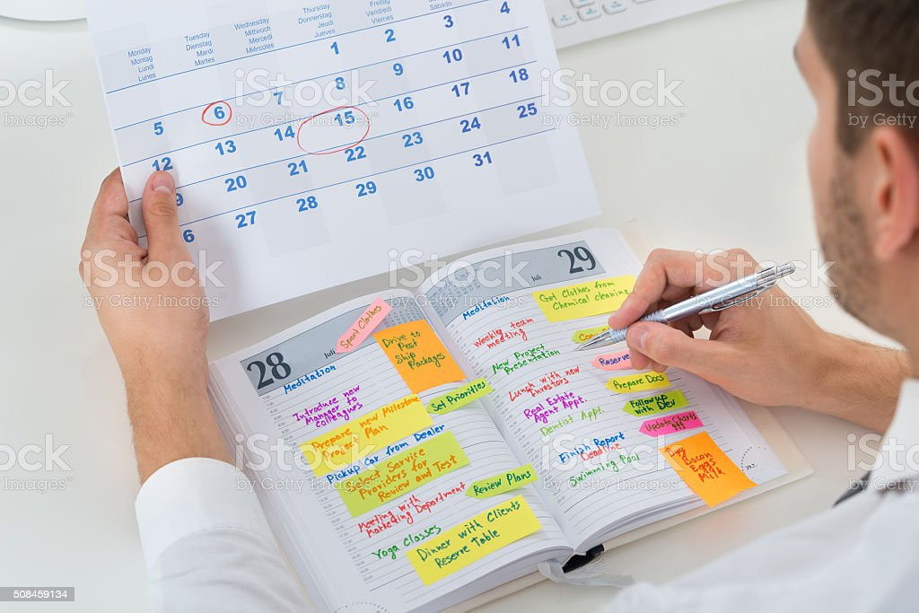 Businessman With Calendar And Diary stock photo