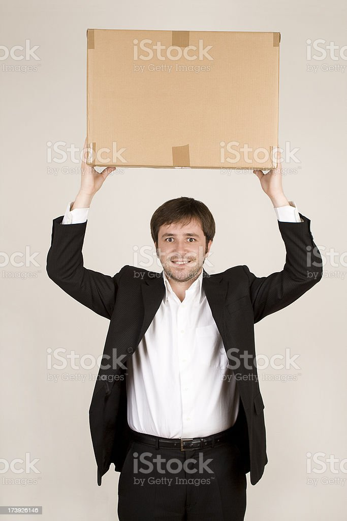 Businessman with cardboard box royalty-free stock photo