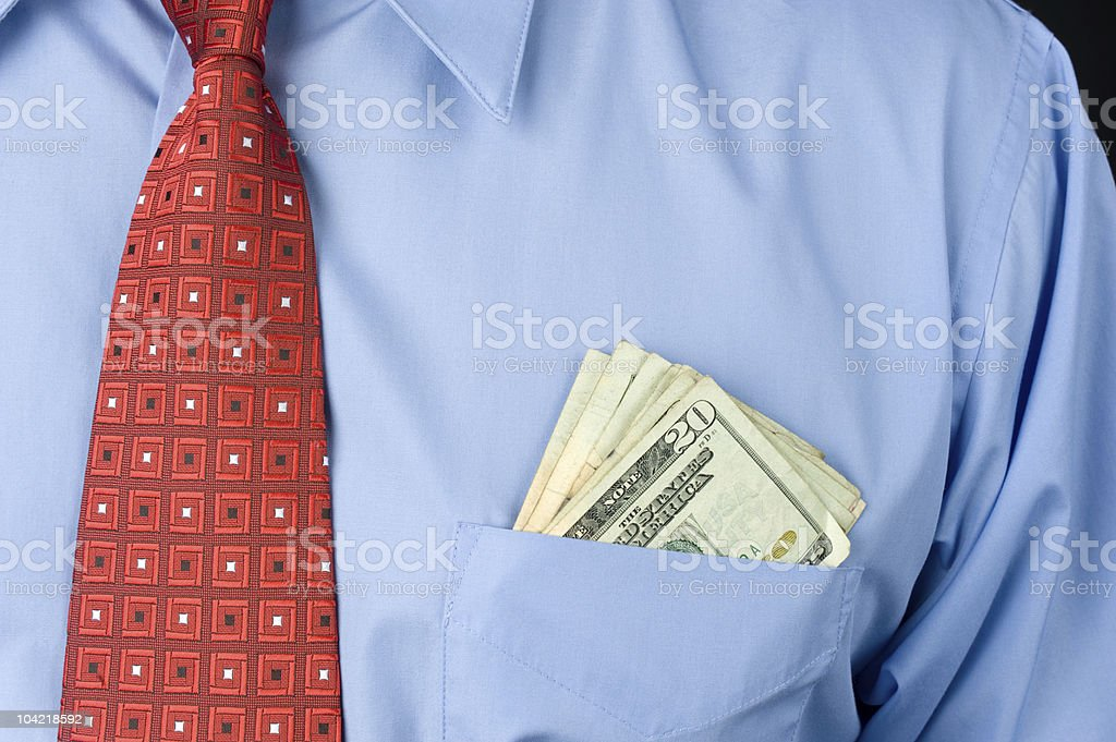Businessman with cash in pocket stock photo