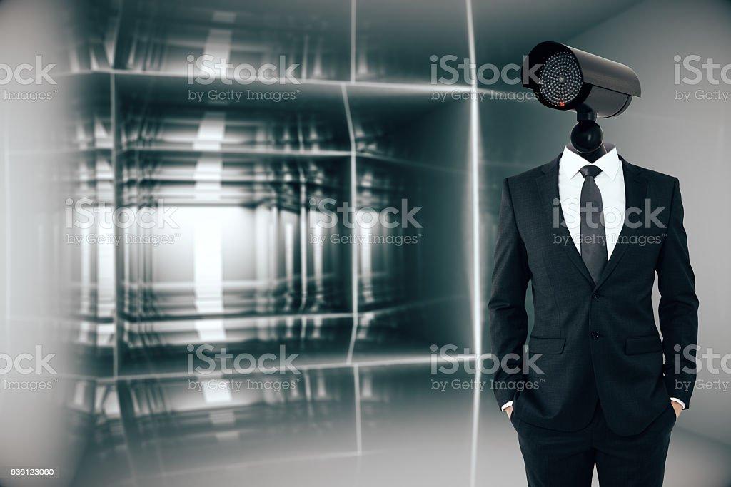 Businessman with CCTV camera head stock photo