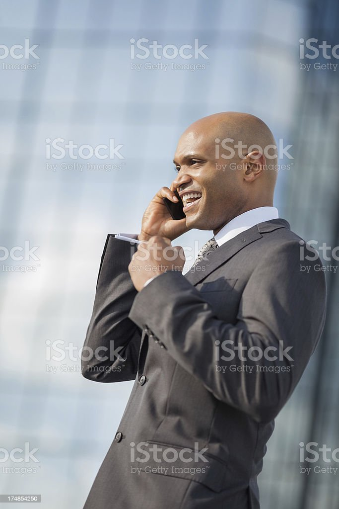 Businessman With Clenched Fist On Call royalty-free stock photo