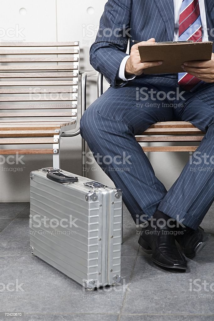 Businessman with clipboard royalty-free stock photo