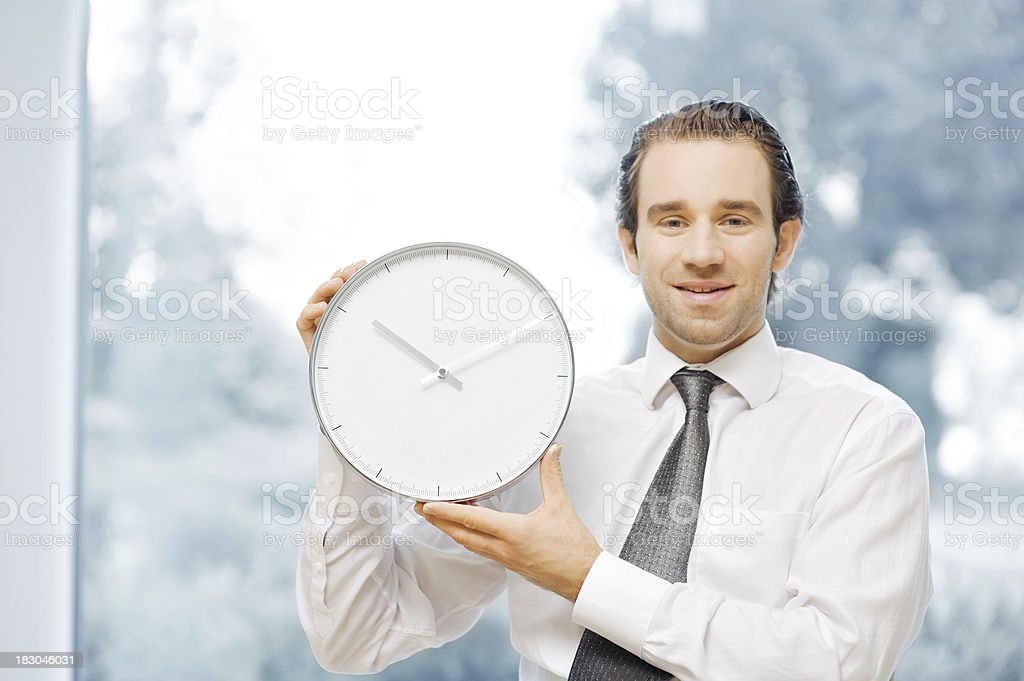 Businessman with clock royalty-free stock photo