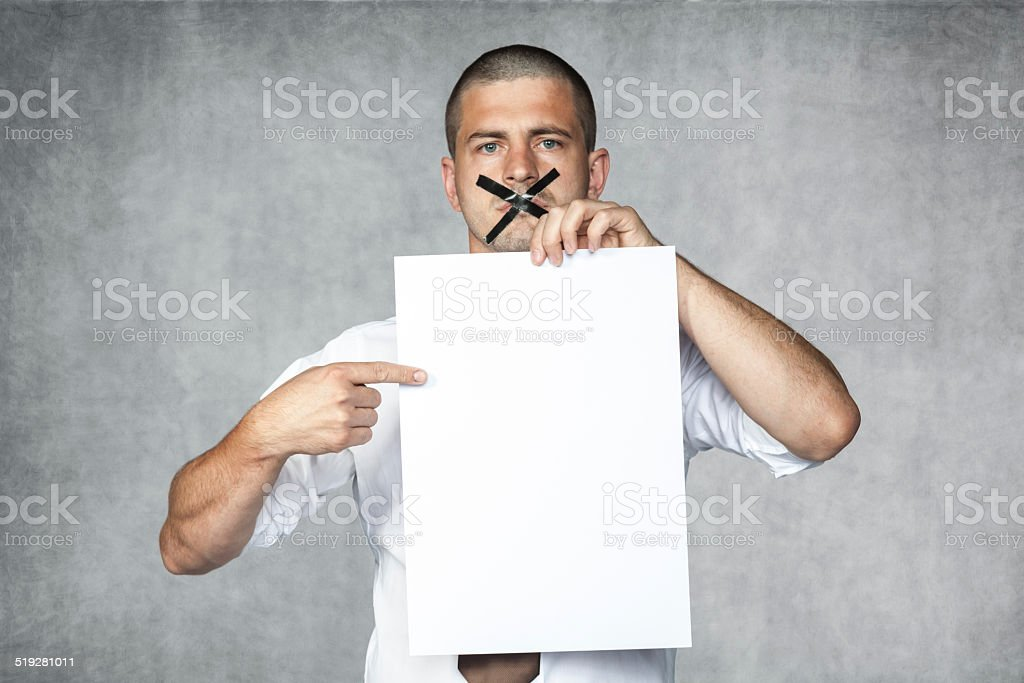 businessman with closed mouth stock photo