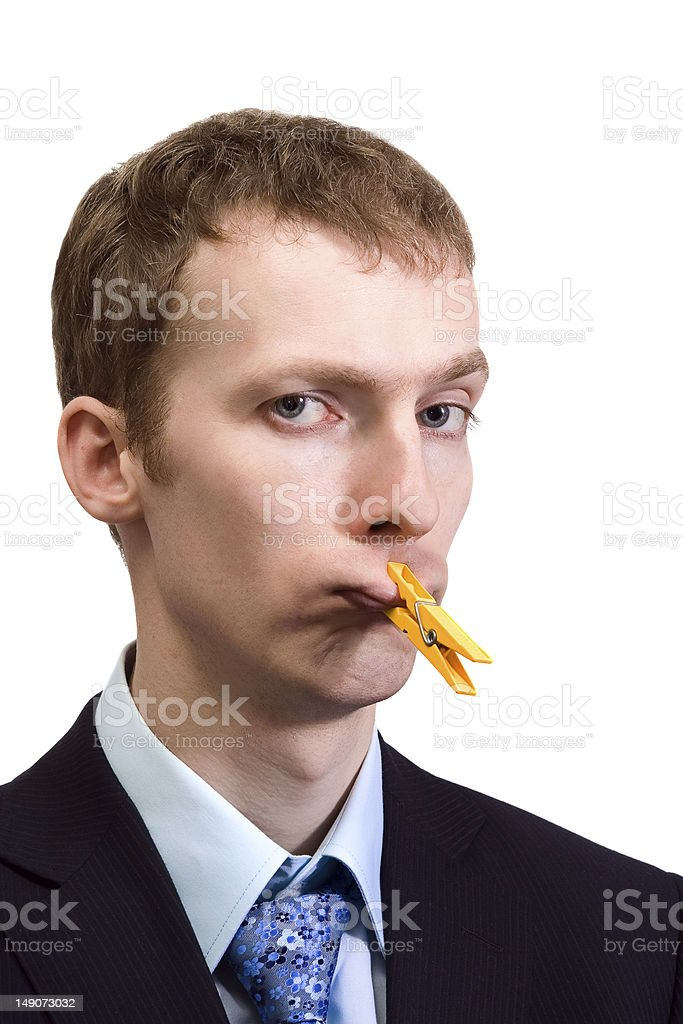 Businessman with clothespin on his mouth royalty-free stock photo