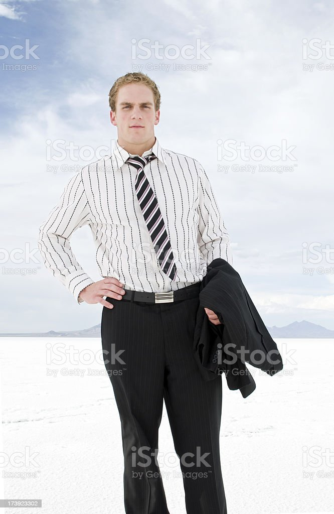 Businessman with coat off stock photo