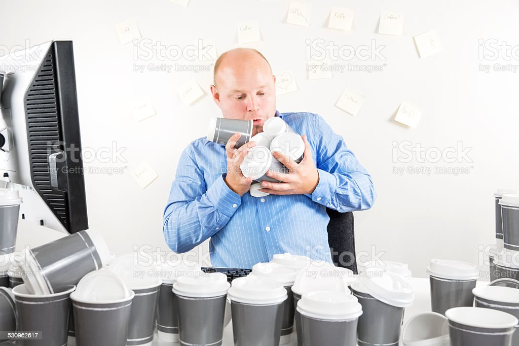 Businessman with coffee addiction stock photo