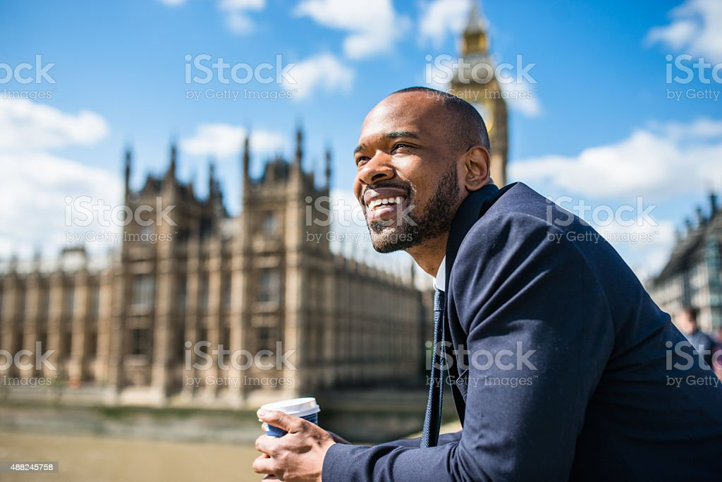 Businessman with coffee mug chilling in London stock photo