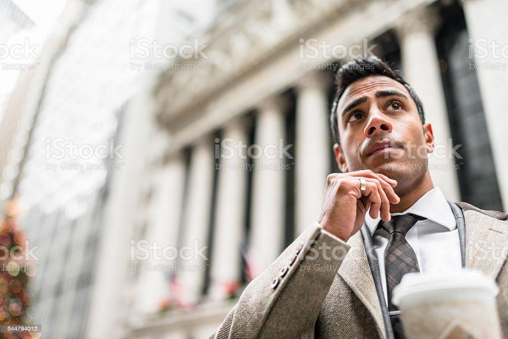 Businessman with coffee mug on wall street stock photo