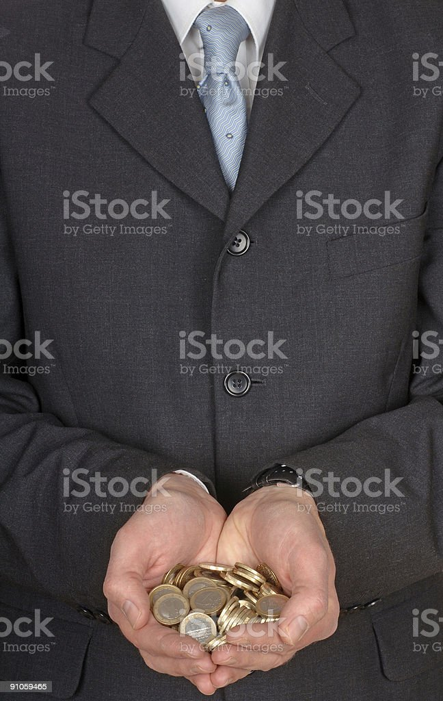 Businessman with coin money in his hands royalty-free stock photo