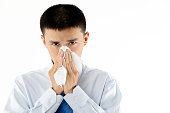 Businessman with cold blowing nose