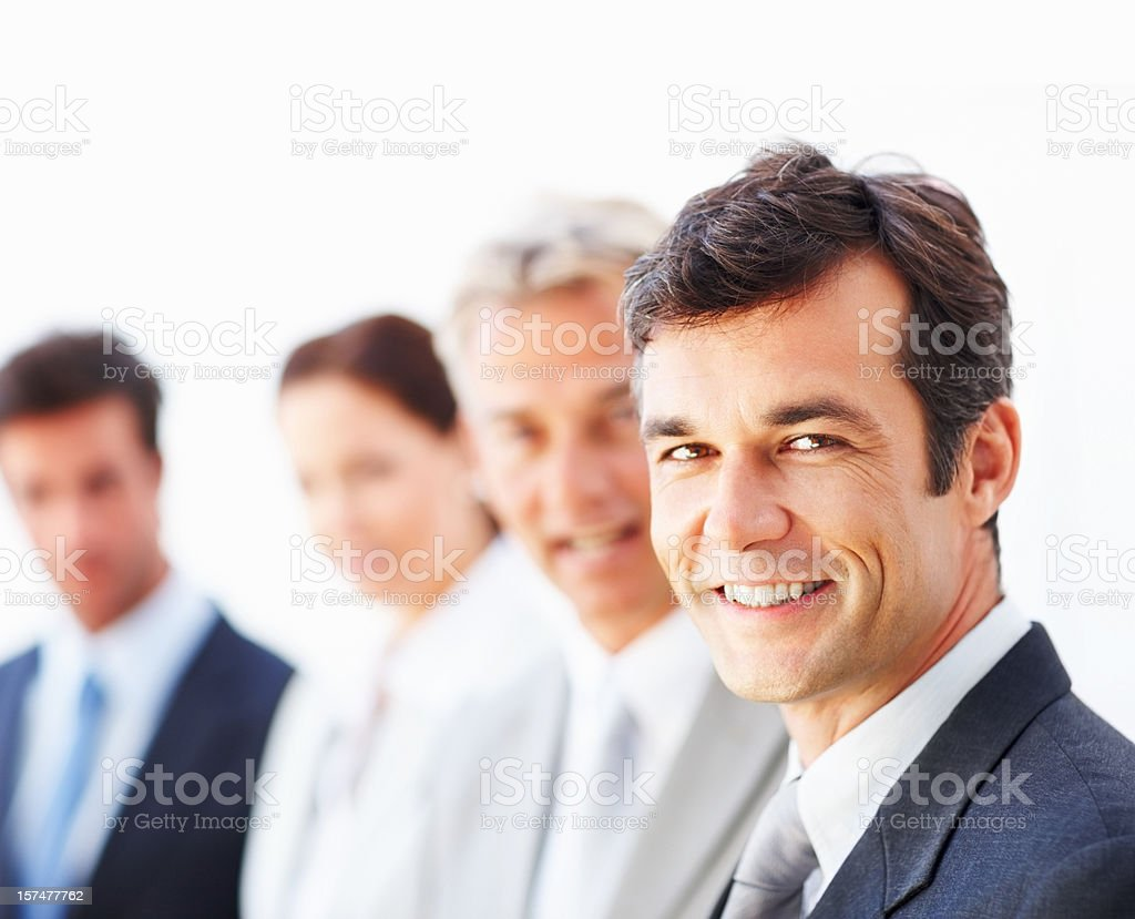 Businessman with colleagues in background royalty-free stock photo