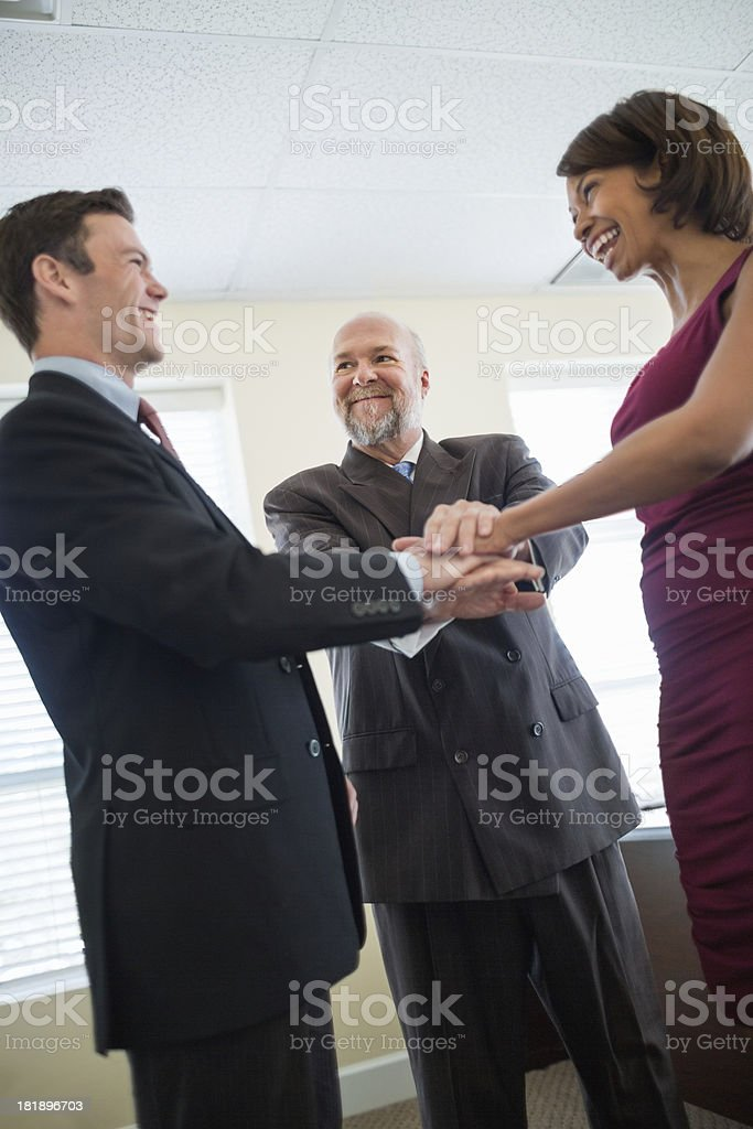 Businessman With Colleagues Stacking Hands royalty-free stock photo