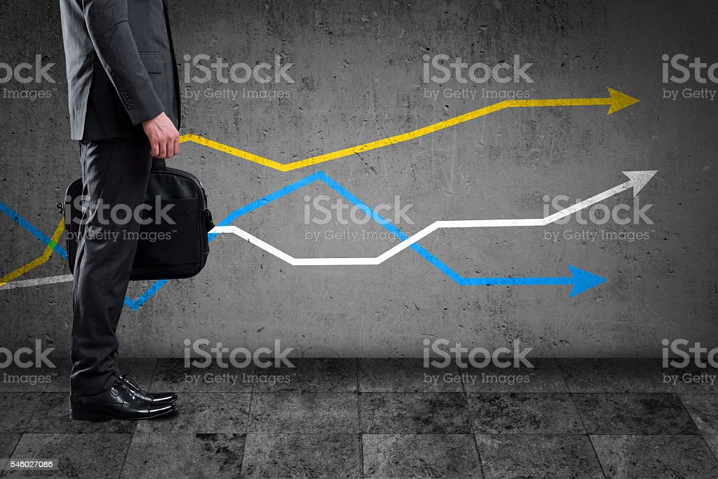 Businessman with colorful line graph stock photo