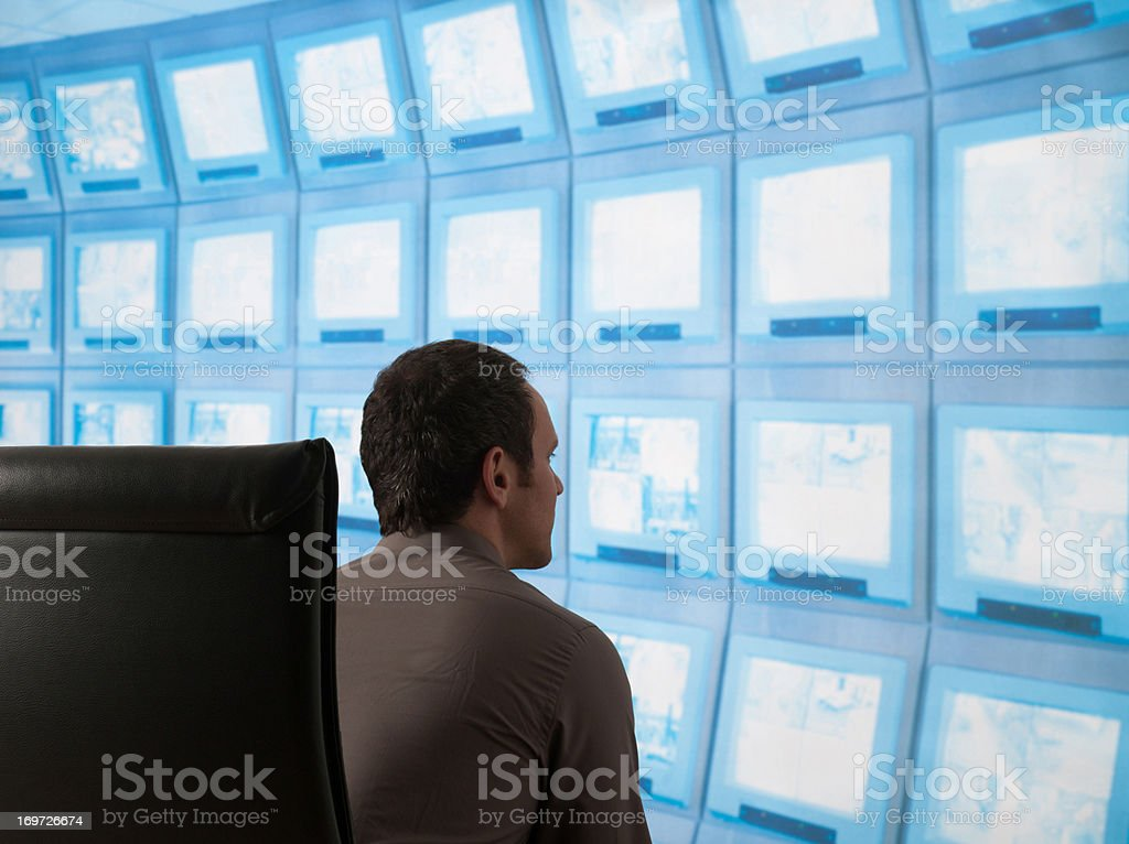 Businessman with computer screen in background royalty-free stock photo