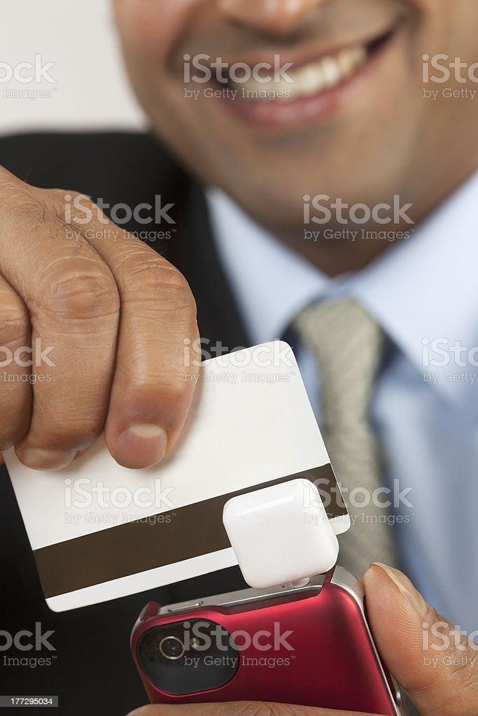 Businessman with credit card swiper stock photo