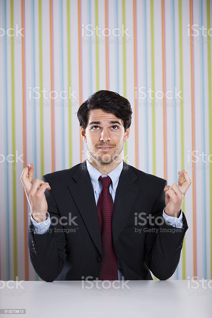 Businessman with cross fingers stock photo