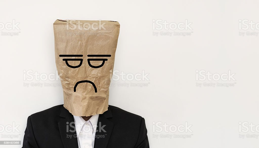 Businessman with crumpled paper bag, with bored anger face stock photo