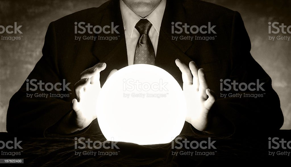 Businessman with Crystal Ball stock photo