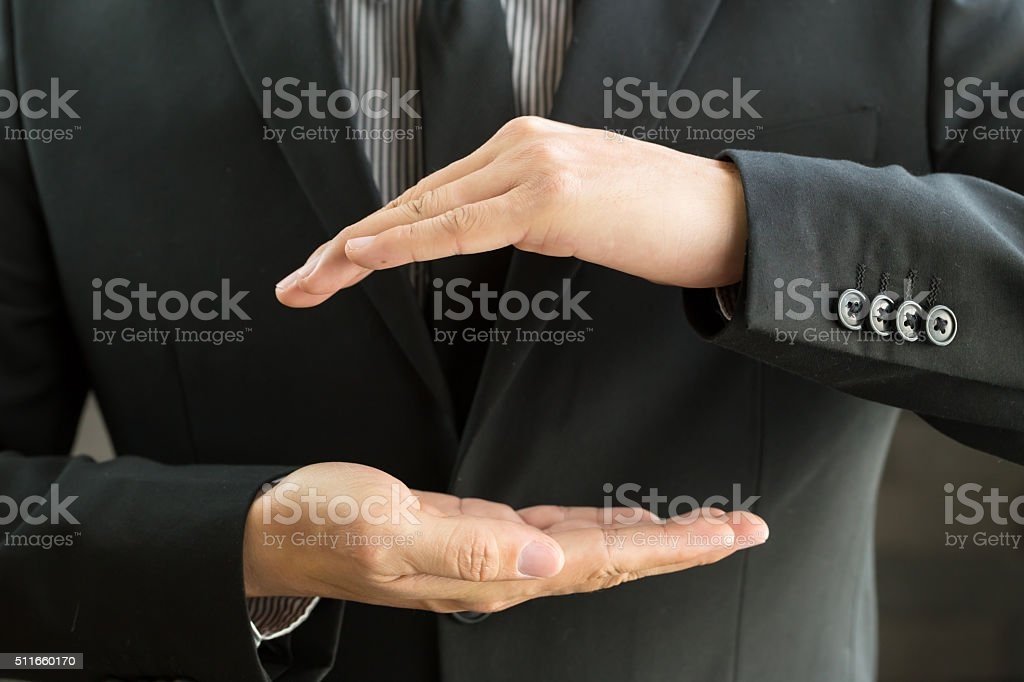 Businessman with cupped hands as if holding something stock photo