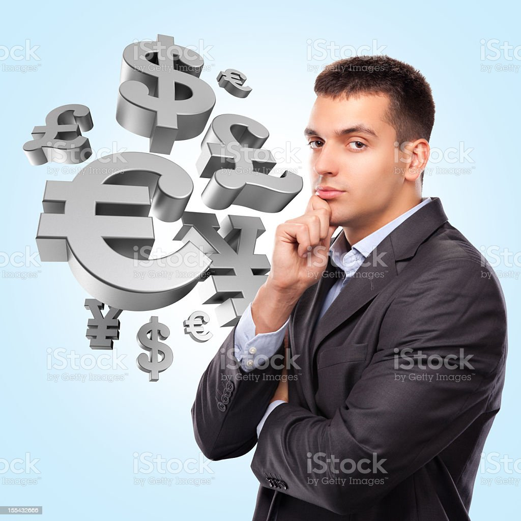 Businessman with currency symbols royalty-free stock photo
