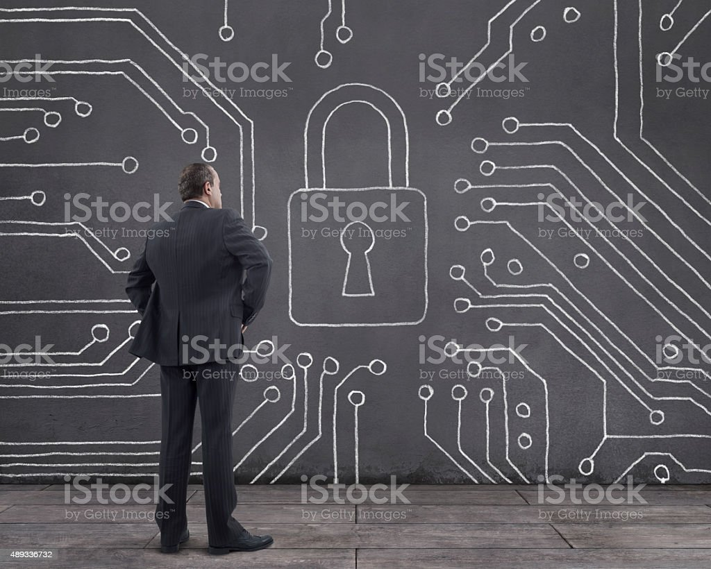 Businessman with Cyber Security Diagram on the Wall stock photo