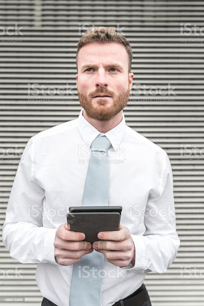 Businessman with device stock photo