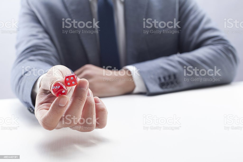 Businessman with Dice stock photo