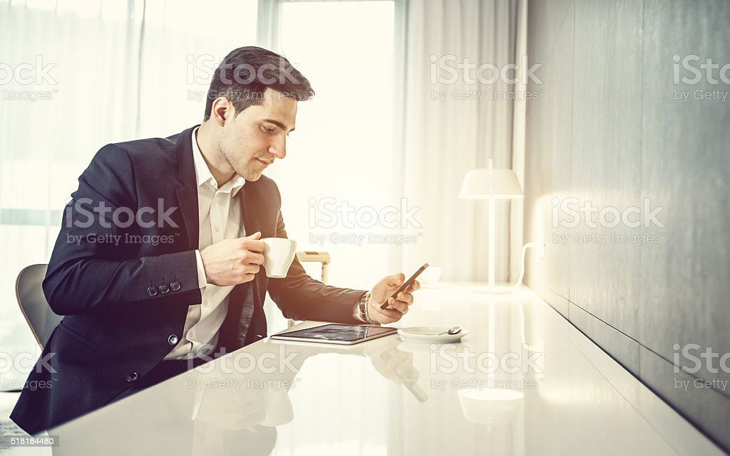 Businessman with digital tablet and phone stock photo