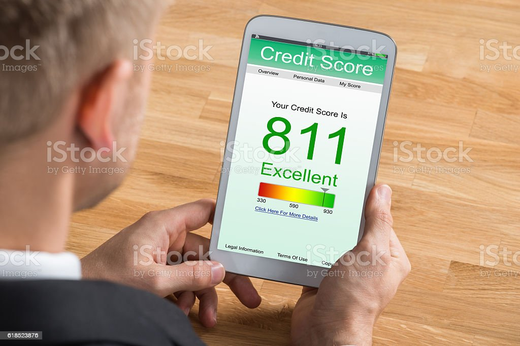 Businessman With Digital Tablet Showing Credit Score stock photo